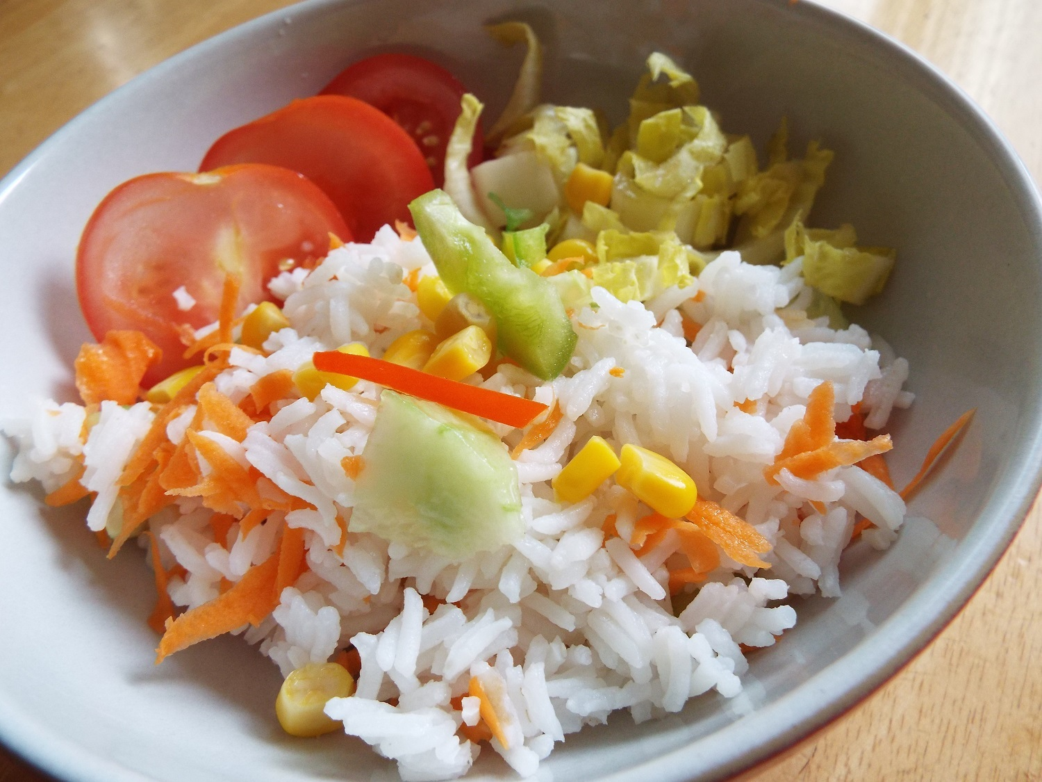 Rice Salad - This is such a simple 'side'. It's cold cooked rice (white or wholegrain) with salad ingredients such as tomato, cucumber, canned sweetcorn, carrot and lettuce or chicory - whatever's in season, available and affordable, really.Serve with a simple dressing of olive or vegetable oil, and lemon juice or vinegar, mixed together with seasoning.Vegan; vegetarian; gluten-free; health-aware
