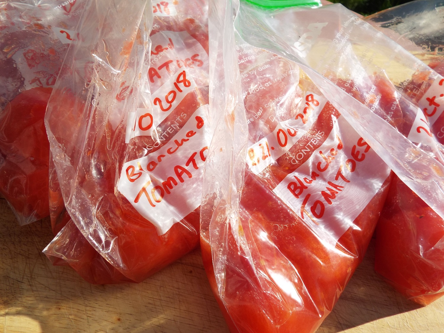 Bags of tomatoes to freeze - a lot easier than I thought it would be