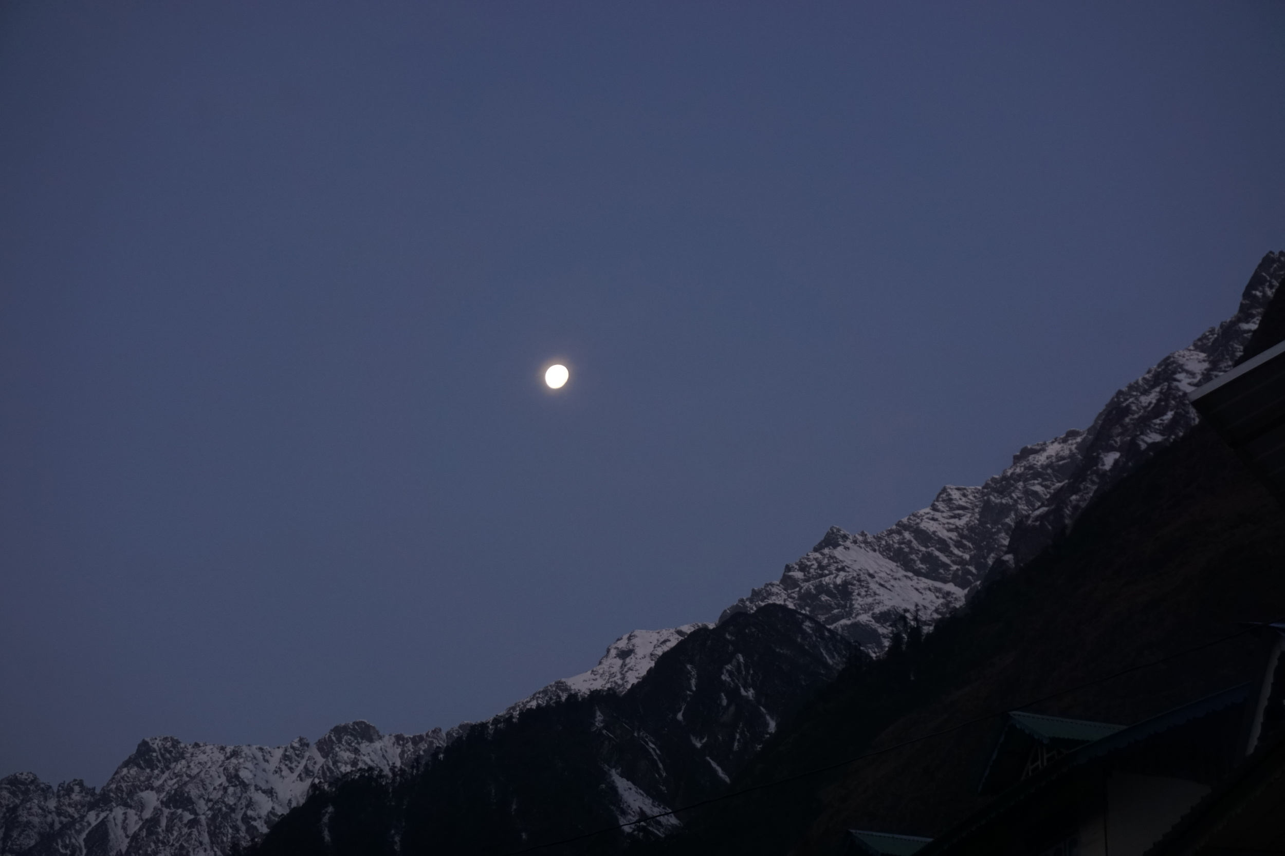 moon riding high in the himalayan sky. signs of clear beautiful skies - sikkim a solo travel destination in india
