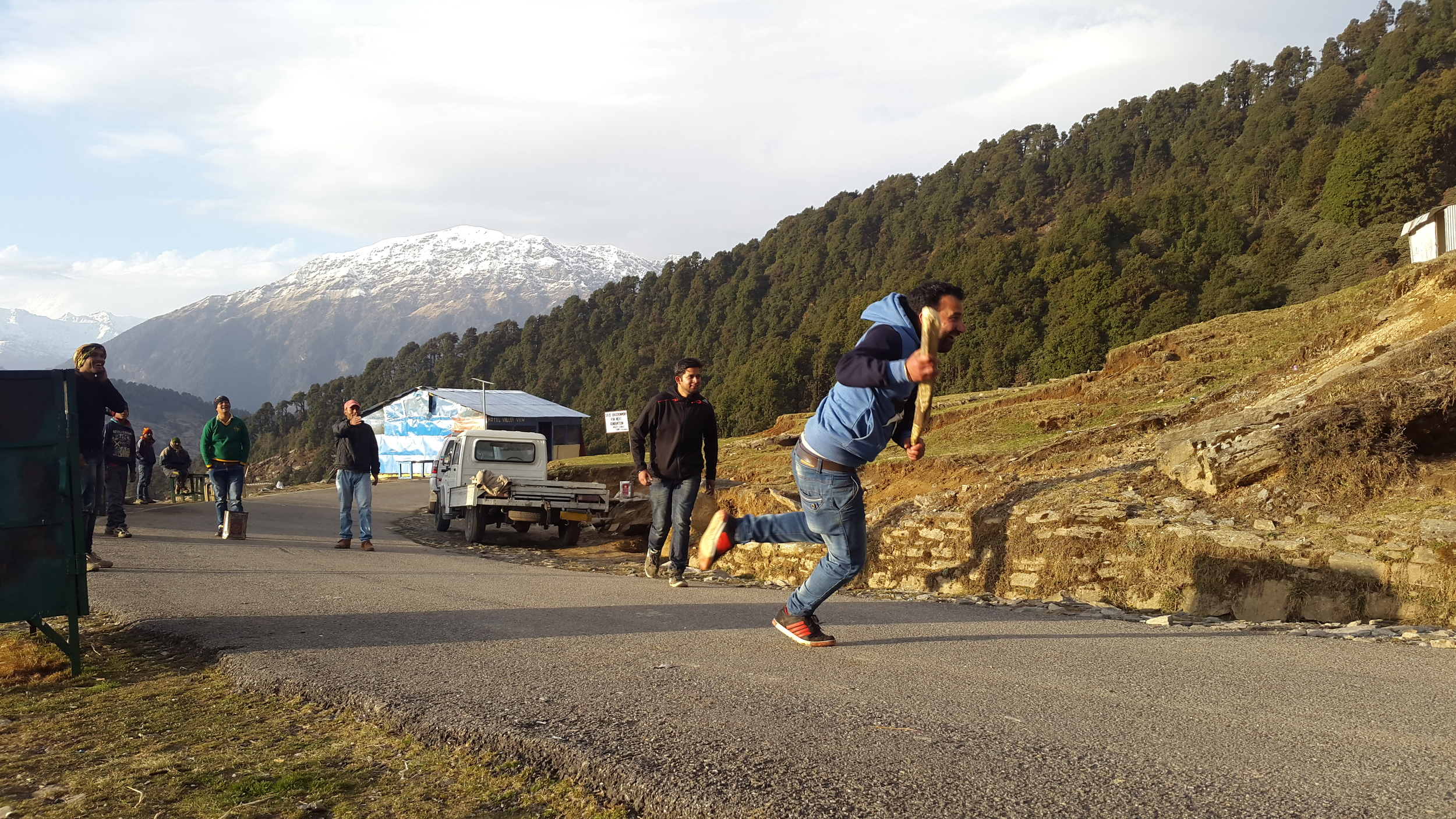 A game of cricket in the mountains. YASSSS!