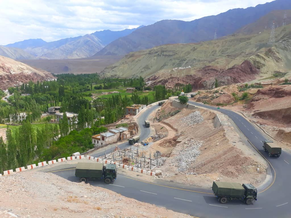 army trucks making their way downwards on the leh to srinagar highway while we scramble upwards