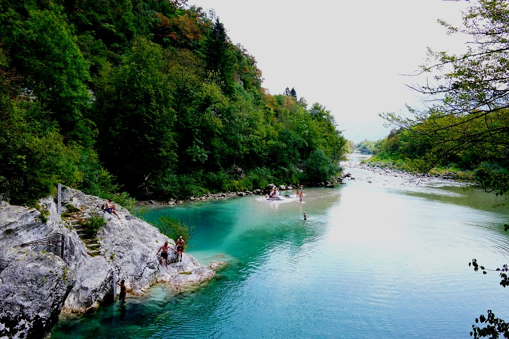 Diving into the deep blue-green waters in Soca Valley, Slovenia