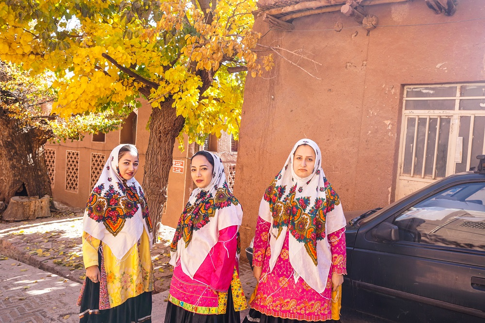 floral prints and pleated skirts, unique dresscode of abyaneh.