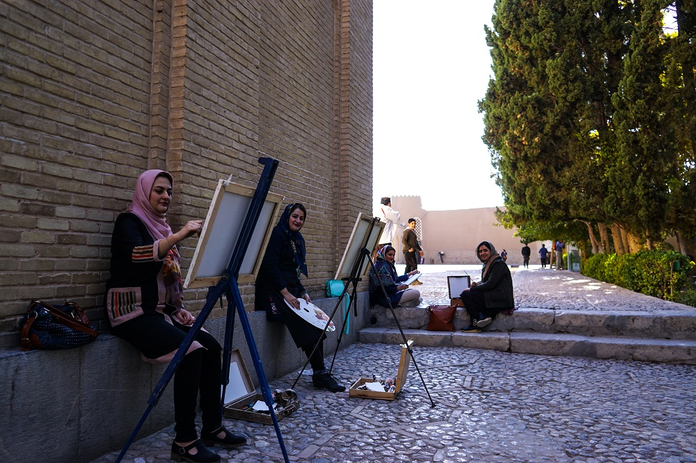 iranians putting their artistic hats on as they indulge in a moment of still life drawings.
