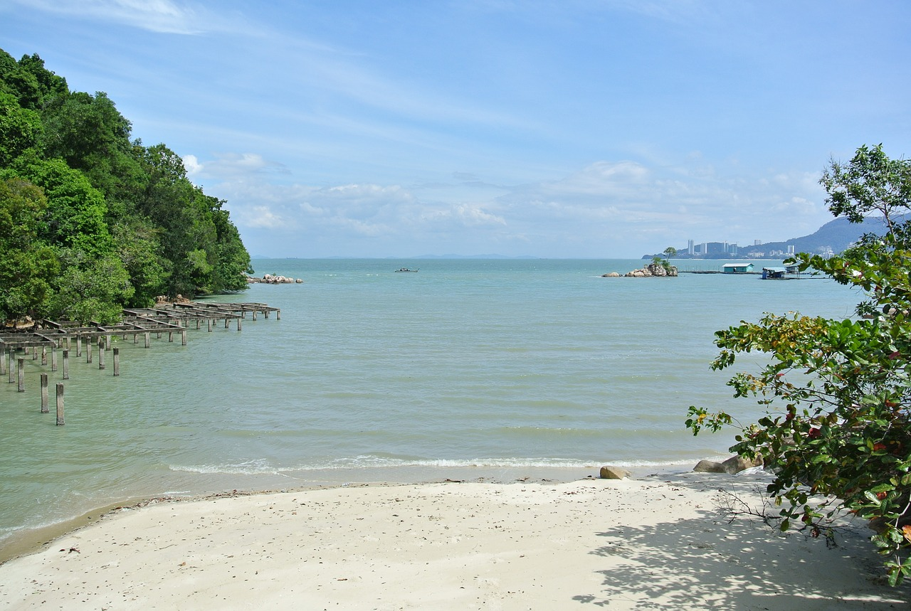 Cycling alongside Batu Feringghi's beach in Penang