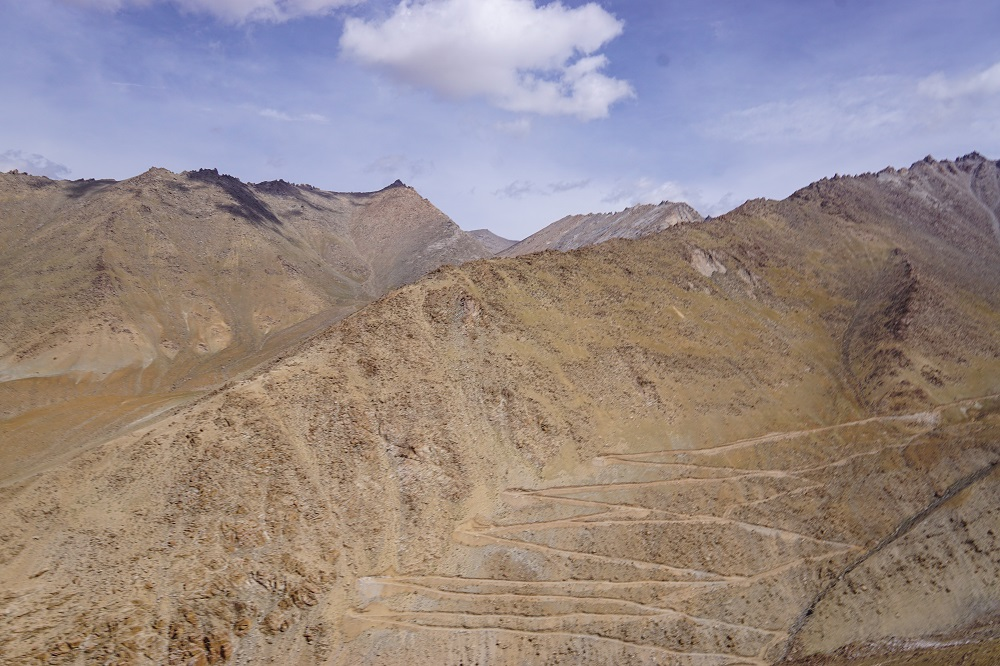 A treacherous climb carved through the mountains in Ladakh - just a glimpse of what it is like to ride here.