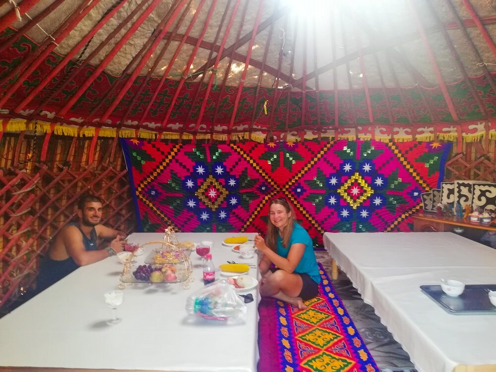 Roberto with Joanna at the Yurt dining table in Saikal Guest House