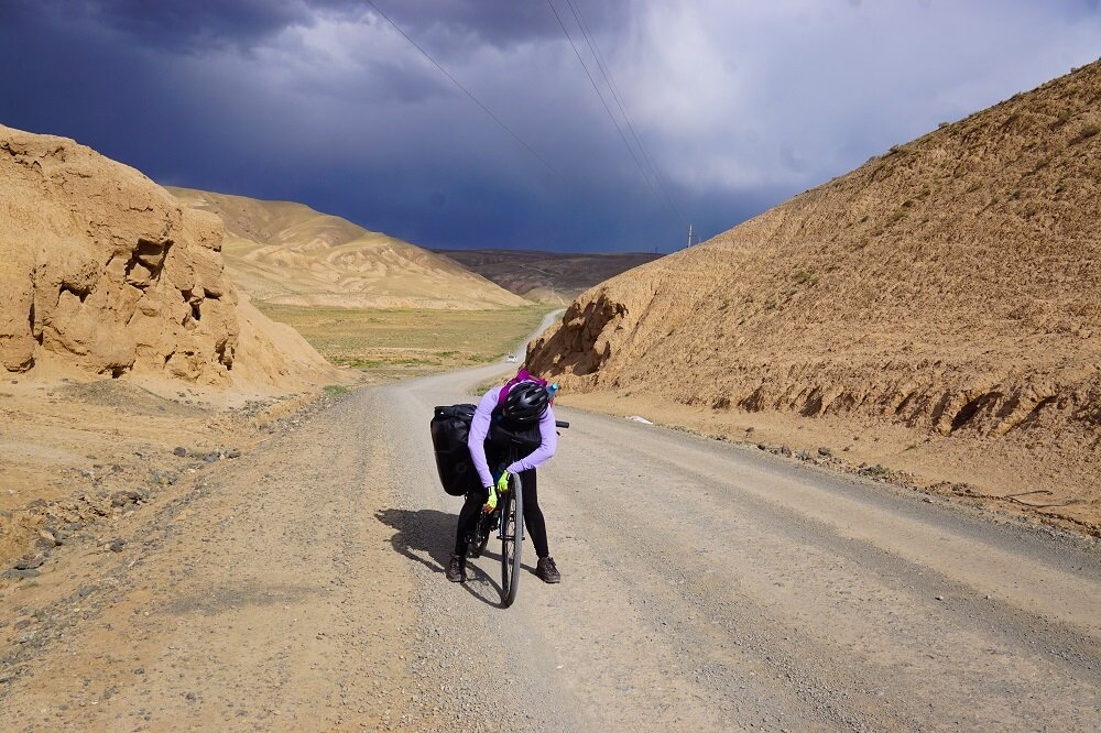 Obviously exhausted and never ashamed to admit defeat sometimes while cycling or bicycle touring in Kyrgyzstan. PC: Joanna