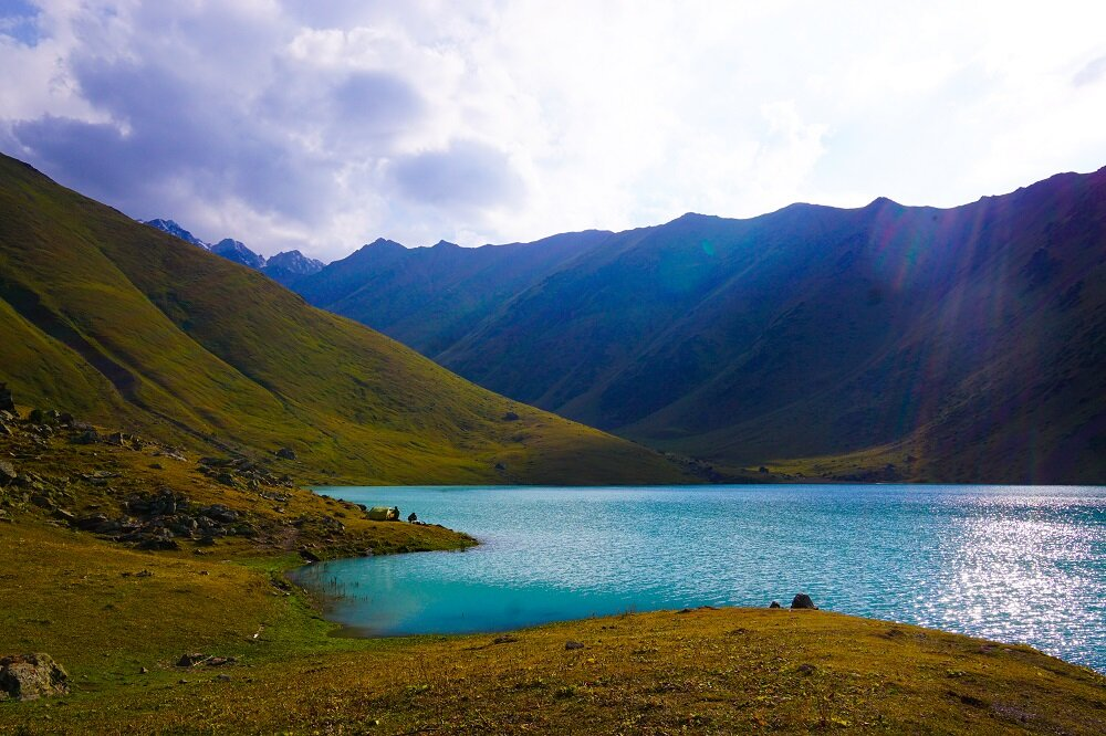 Turquoise blue waters, wild horses and snow-capped peaks, just a taste of what's it like to trek in Kyrgyzstan.
