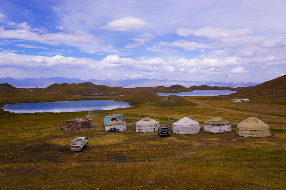 Tulpar-Kol Lake glistens in the afternoon sun next to the CBT yurts.