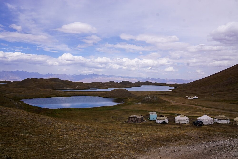 An elevated view of the Tulpar Lake from a hill above CBT Yurt Camp.
