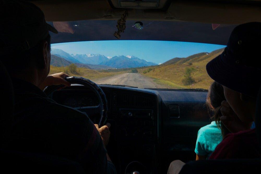 Hitchhiking towards Kol-Tor Lake after taking the marshutka from Bishkek