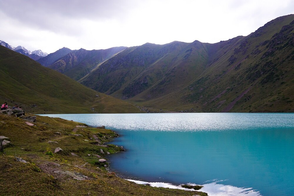 Shimmery blue and emerald-like waters of Kol-Tor Lake on our trek, who knew this was just a day trip from Bishkek.