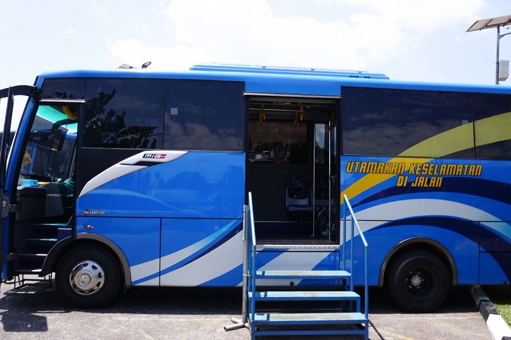 Catching the bus using Belitung's free shuttle services at the airport to the island