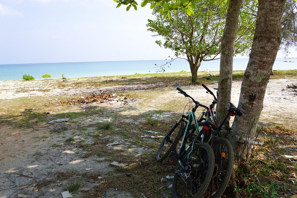 here's us just cycling in belitung and stopping to catch waves and Take a breather