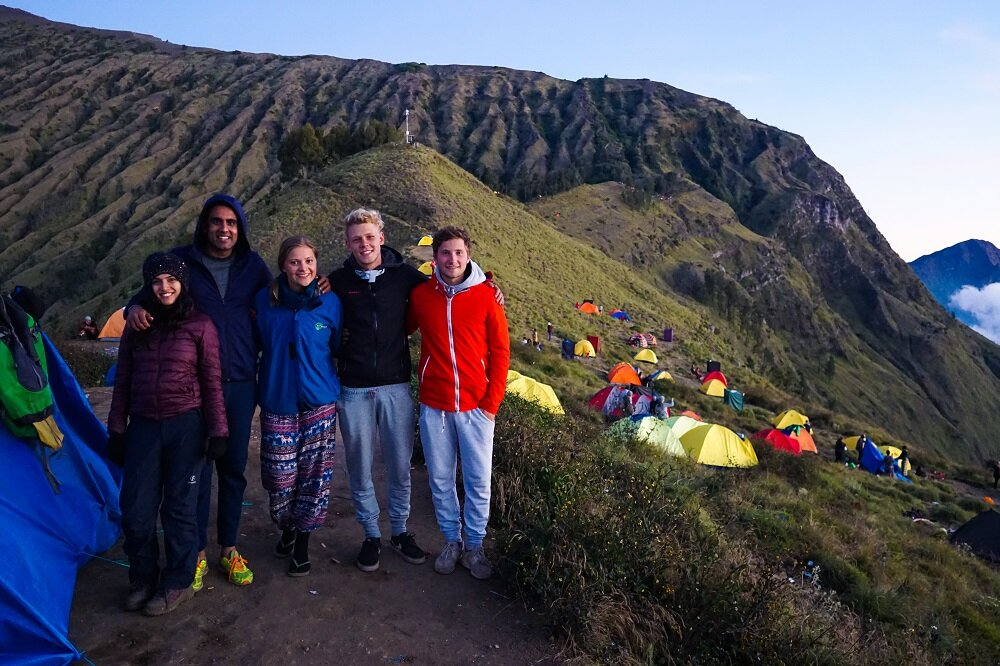 A group of german climbers and us at the ridge of mount rinjani.