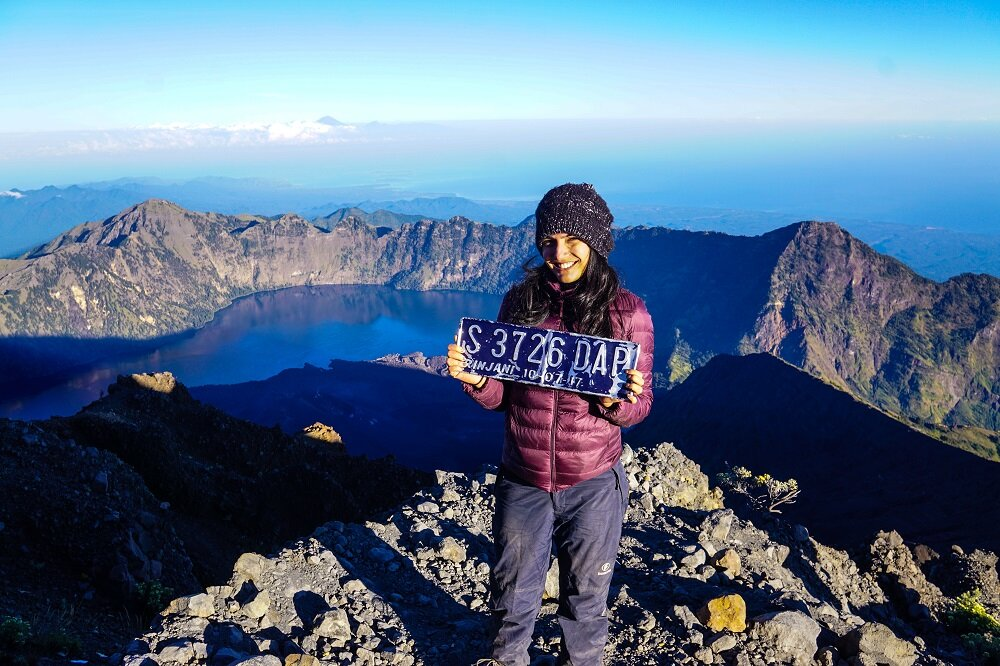 beyond elated and tired after reaching the summit of mount rinjani