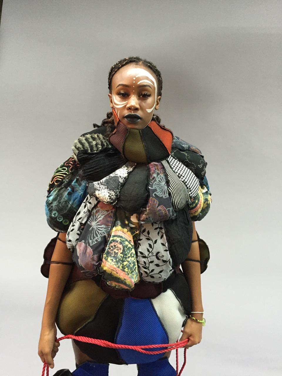 THE UNSPOKEN  - About unconscious discrimination Sculpture/textile/dance. Material: Shield - Textile, H: 165cm, W: 100cm (7 pieces)  © Saba Bereket Persson