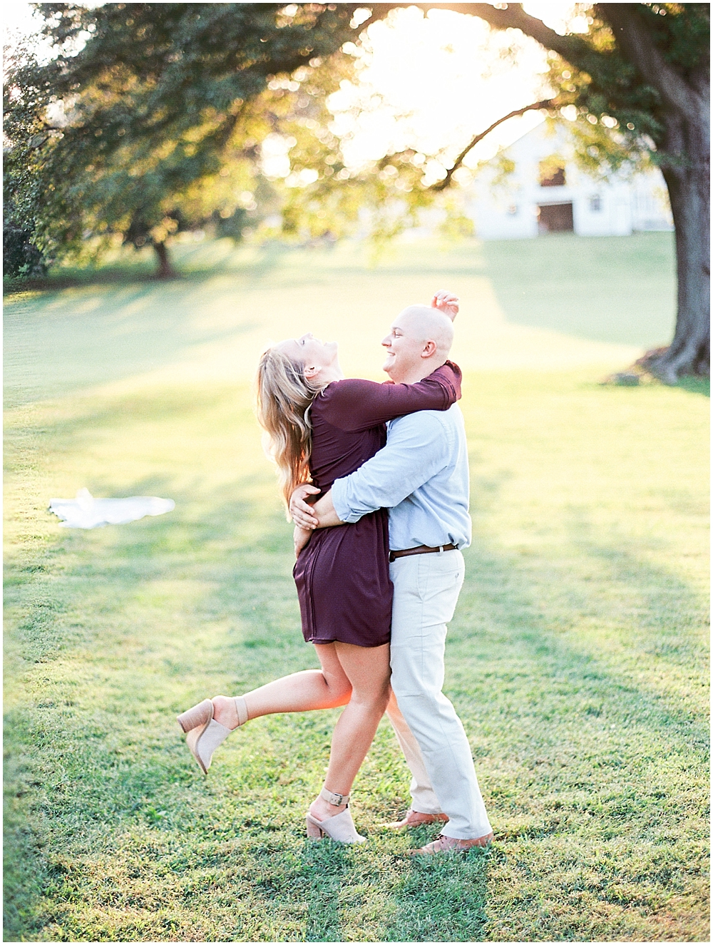 Happy couple spins around during engagement session