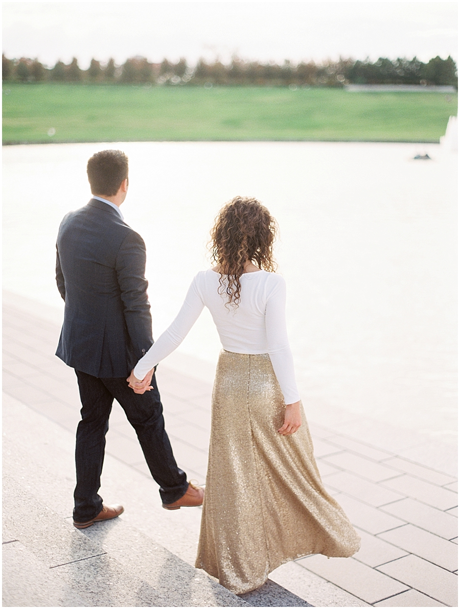 Walking hand-in-hand by the grand basin in Forest Park. #goals