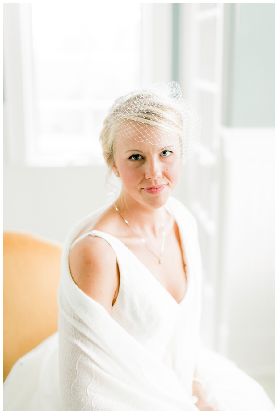 Light and Airy Photos of the bride in front of a window_0011.jpg
