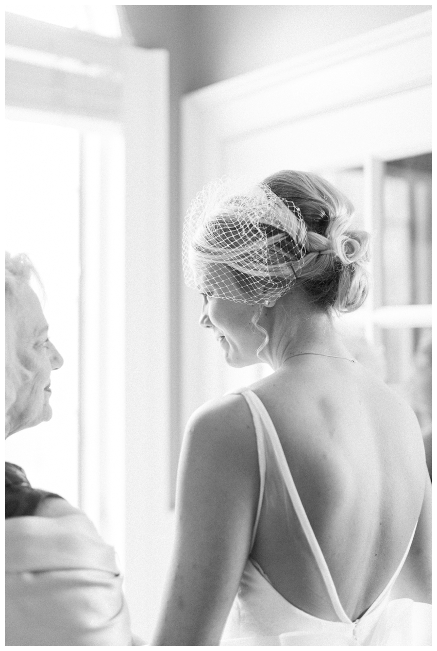 Light and Airy Photos of the bride in front of a window_0017.jpg