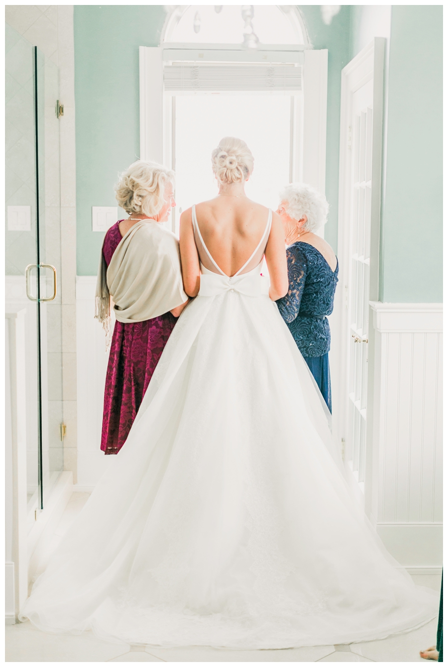 Light and Airy Photos of the bride in front of a window_0015.jpg