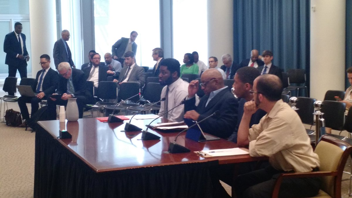 APACC Members Malusi and Keith Kitchen testify at a budget hearing in 2017.