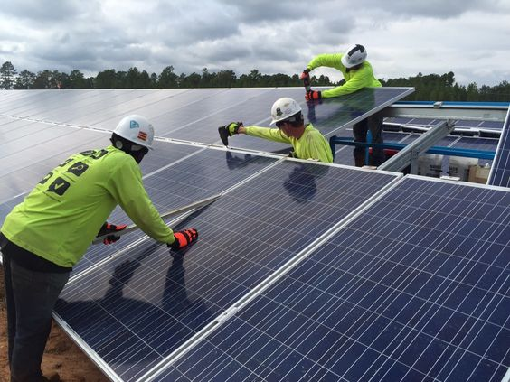 Image:  Washington Post . Solar farms create jobs and produce energy and reduce costs of nearby facilities.