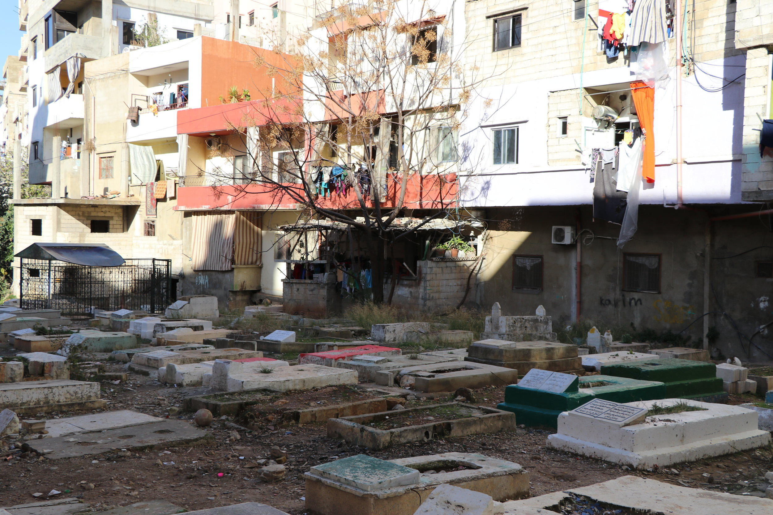 The camp's thresholds continue to expand, blurring the beginning and end of the cemetery and the houses surrounding it. (c) E. Fiddian-Qasmiyeh. December 2016.]