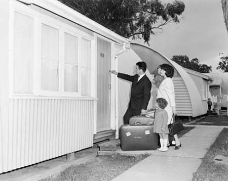 Migrant family entering their accommodation at Maribyrnong Hostel, Melbourne, early 1960s National Archives of Australia (A12111 - 1/1965/22/25)