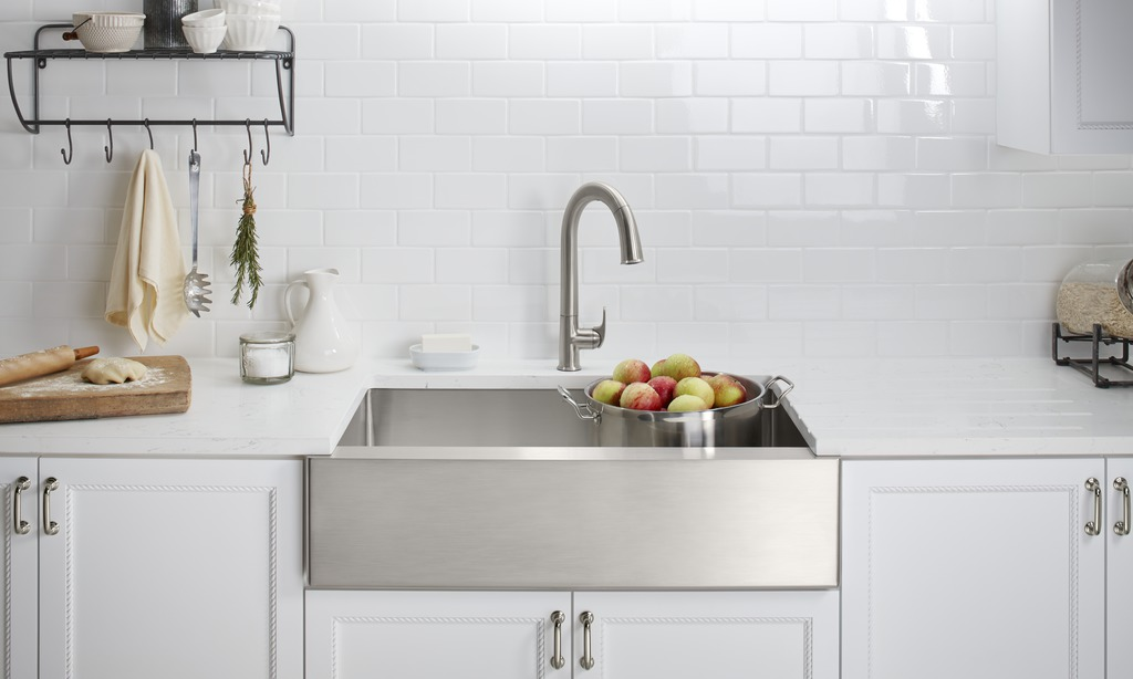 white glossy tile backsplash