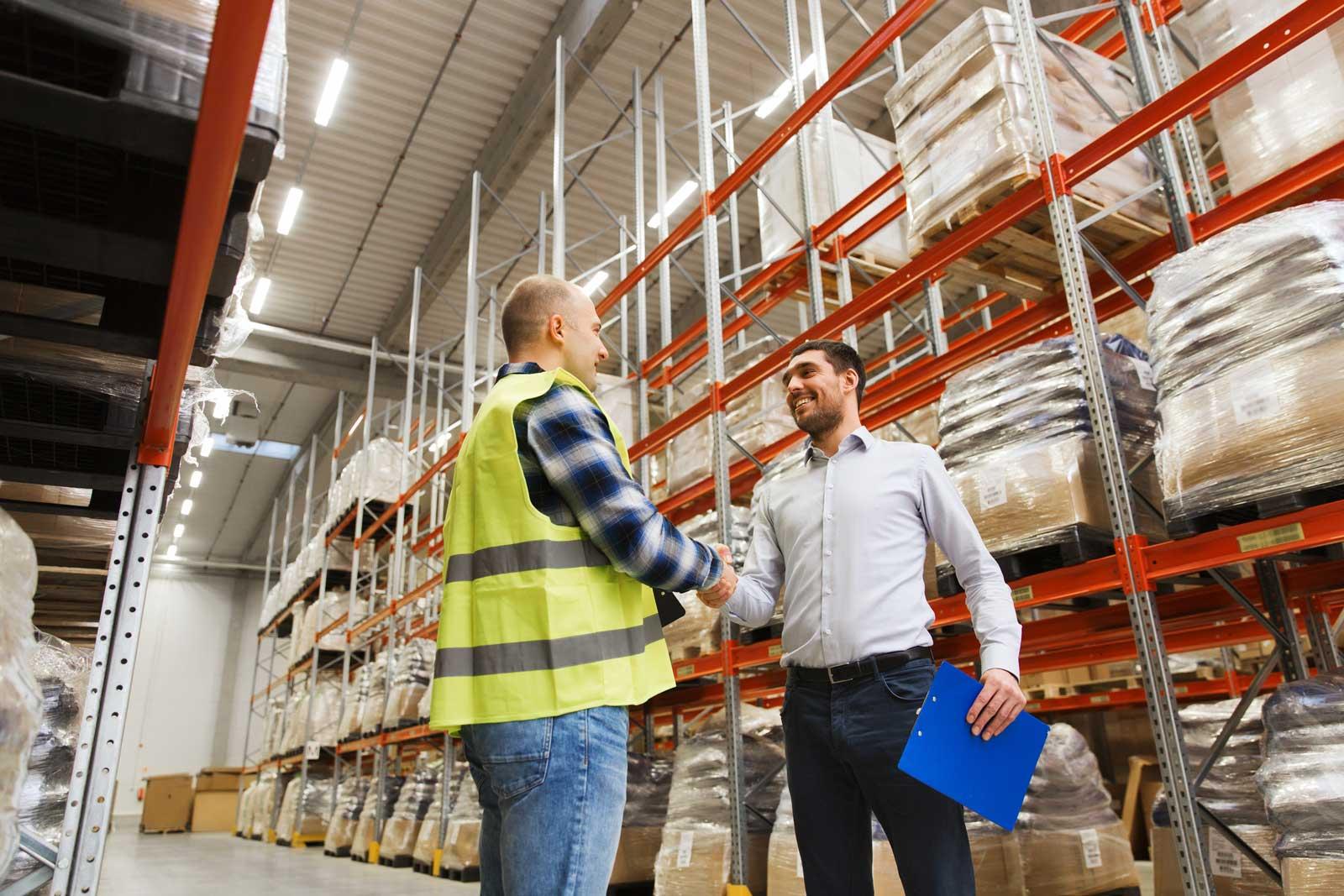 plumbing warehouse workers shaking hands
