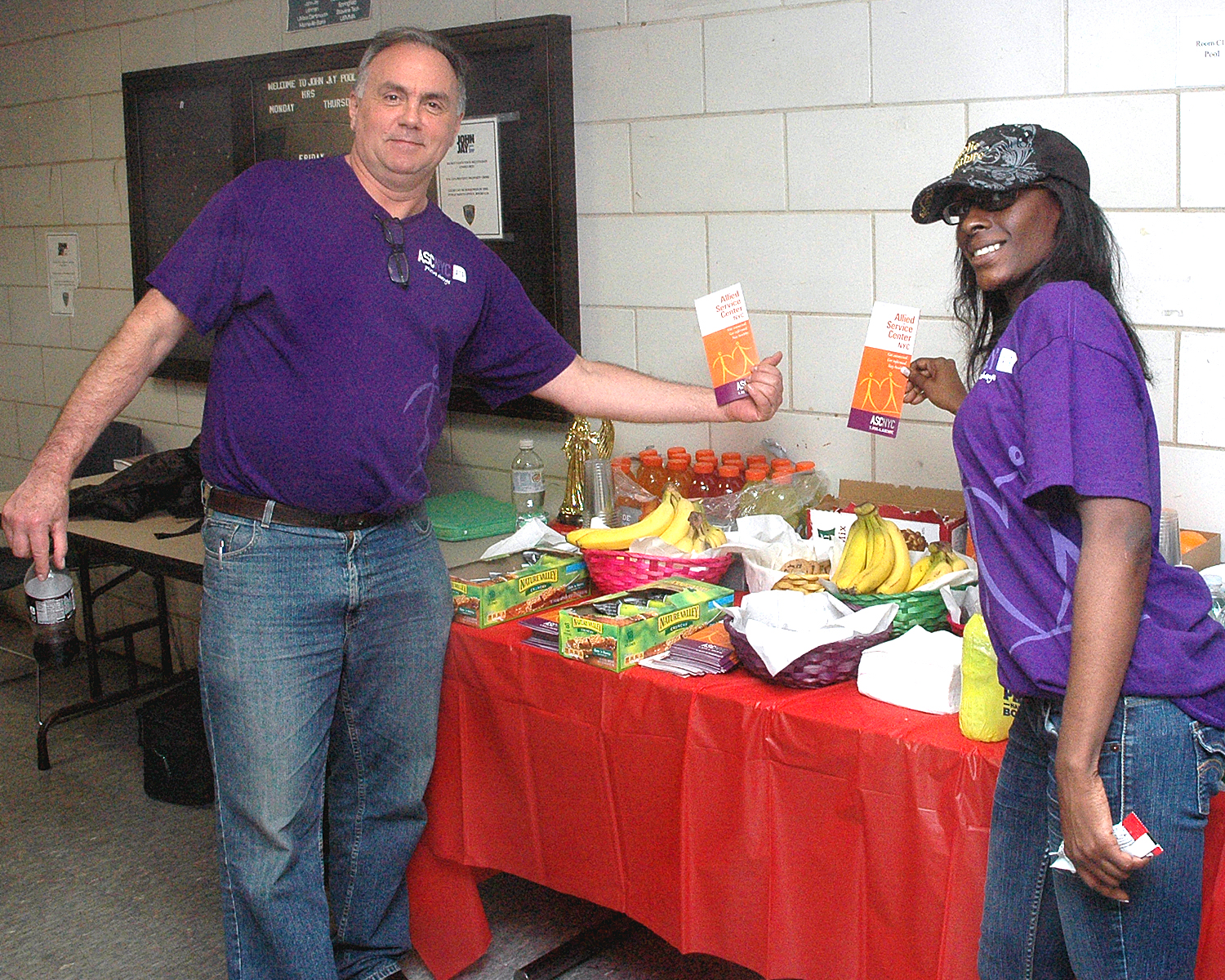 Conrad and Malika at the Outreach/Refreshment table