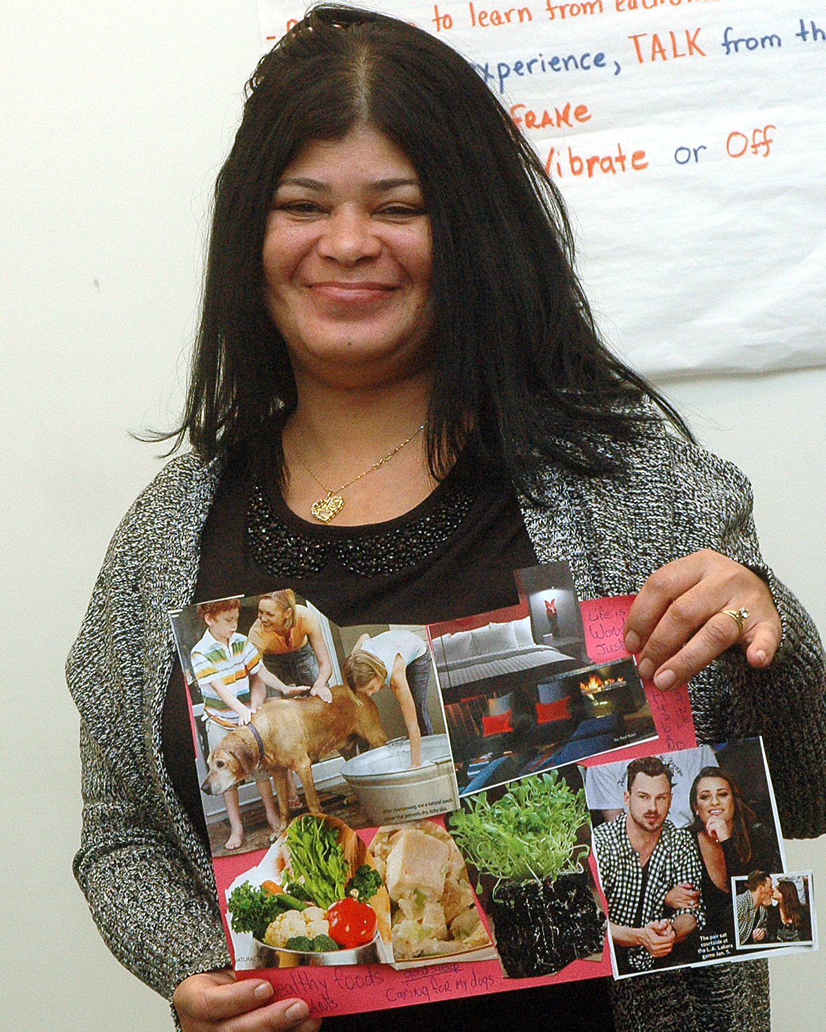 Sol C. showing off the collage that she made during the training
