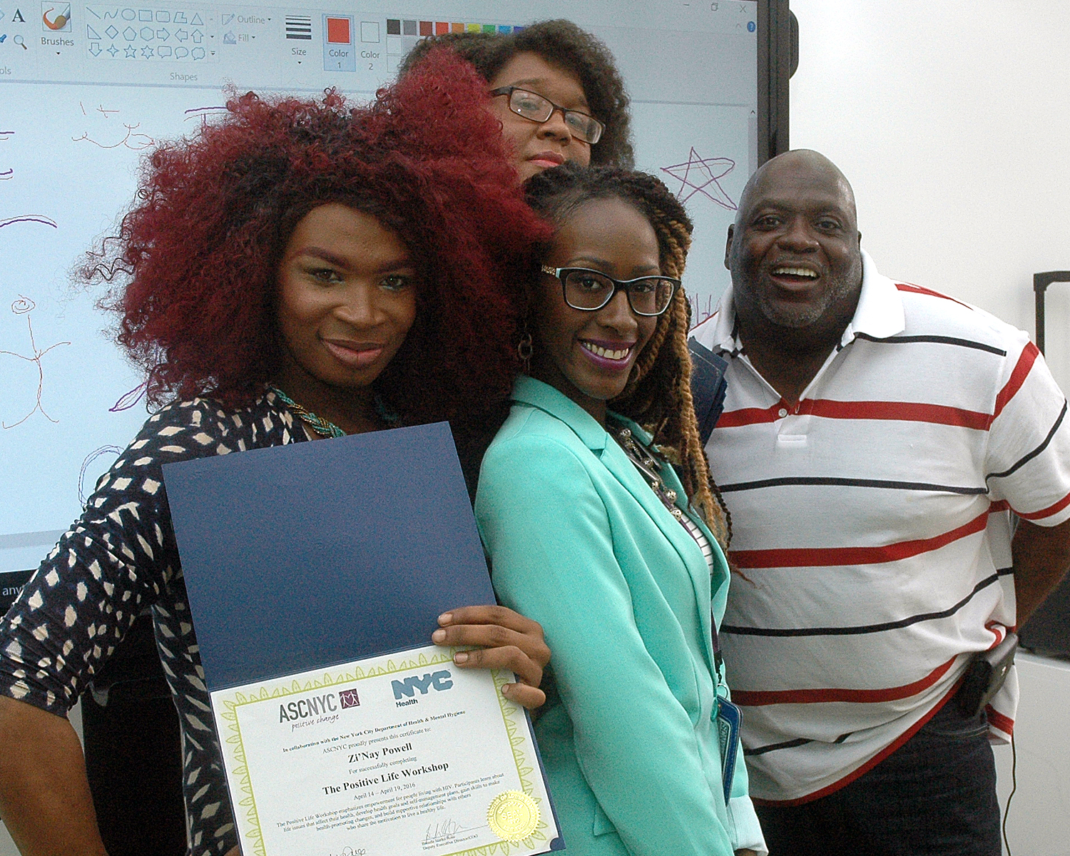 Zi'Nay P. with members of the training team