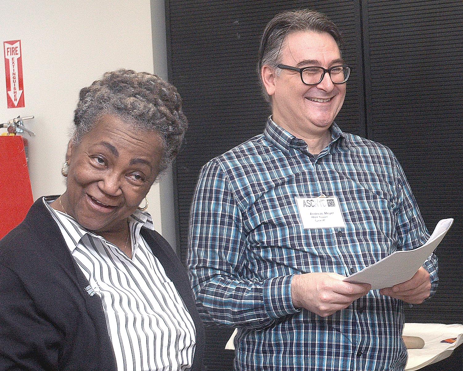 Joyce Myricks and Andreas M. listening to the comments of his final presentation