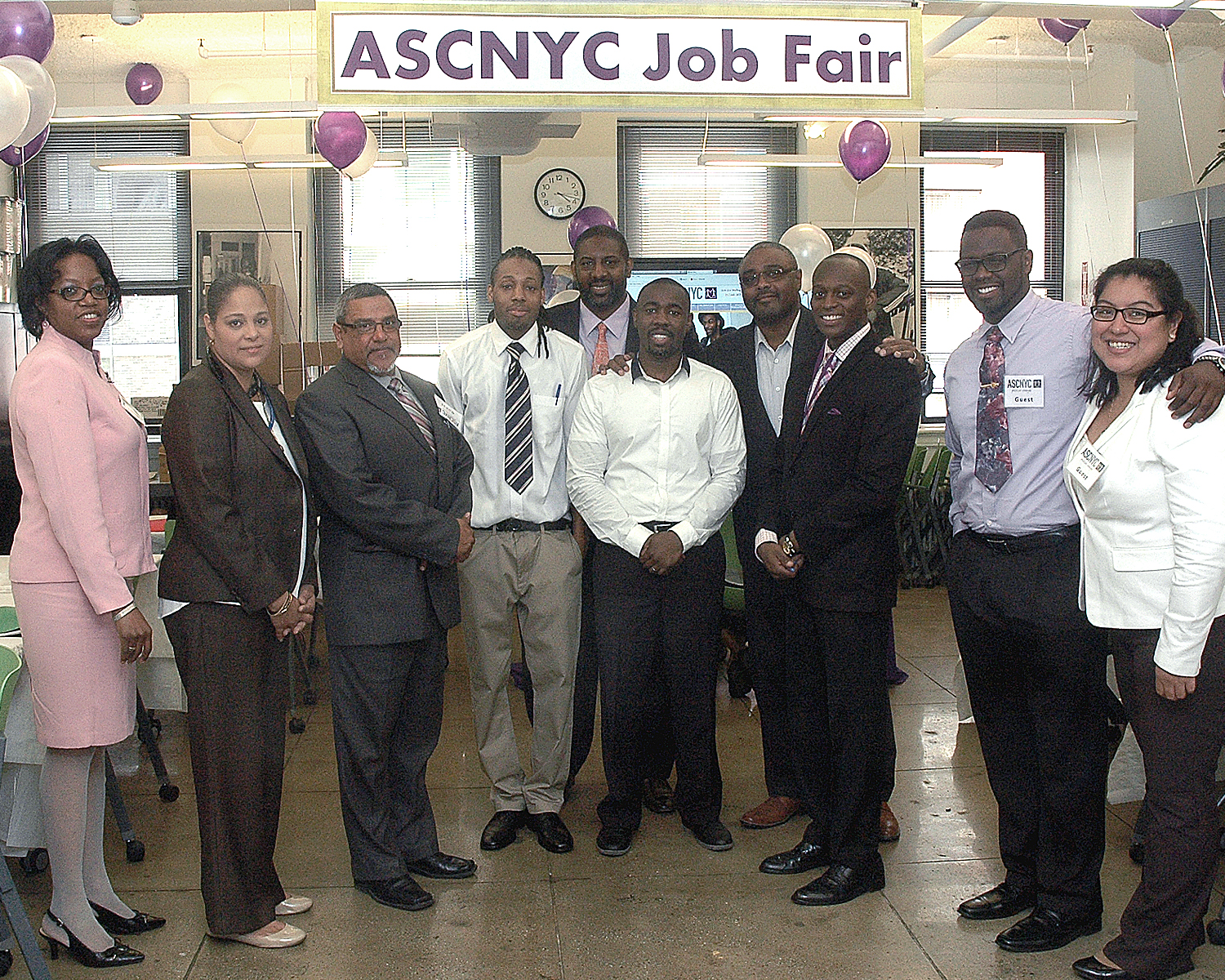 Jean Pierre Louis, Dennis Martin with the Job Fair interviewers and an attendee
