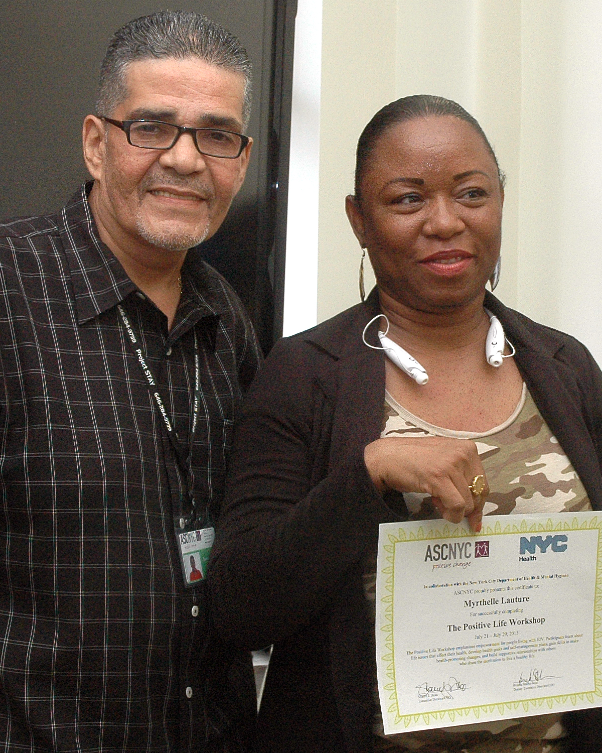Myrthelle L. getting her completion certificate