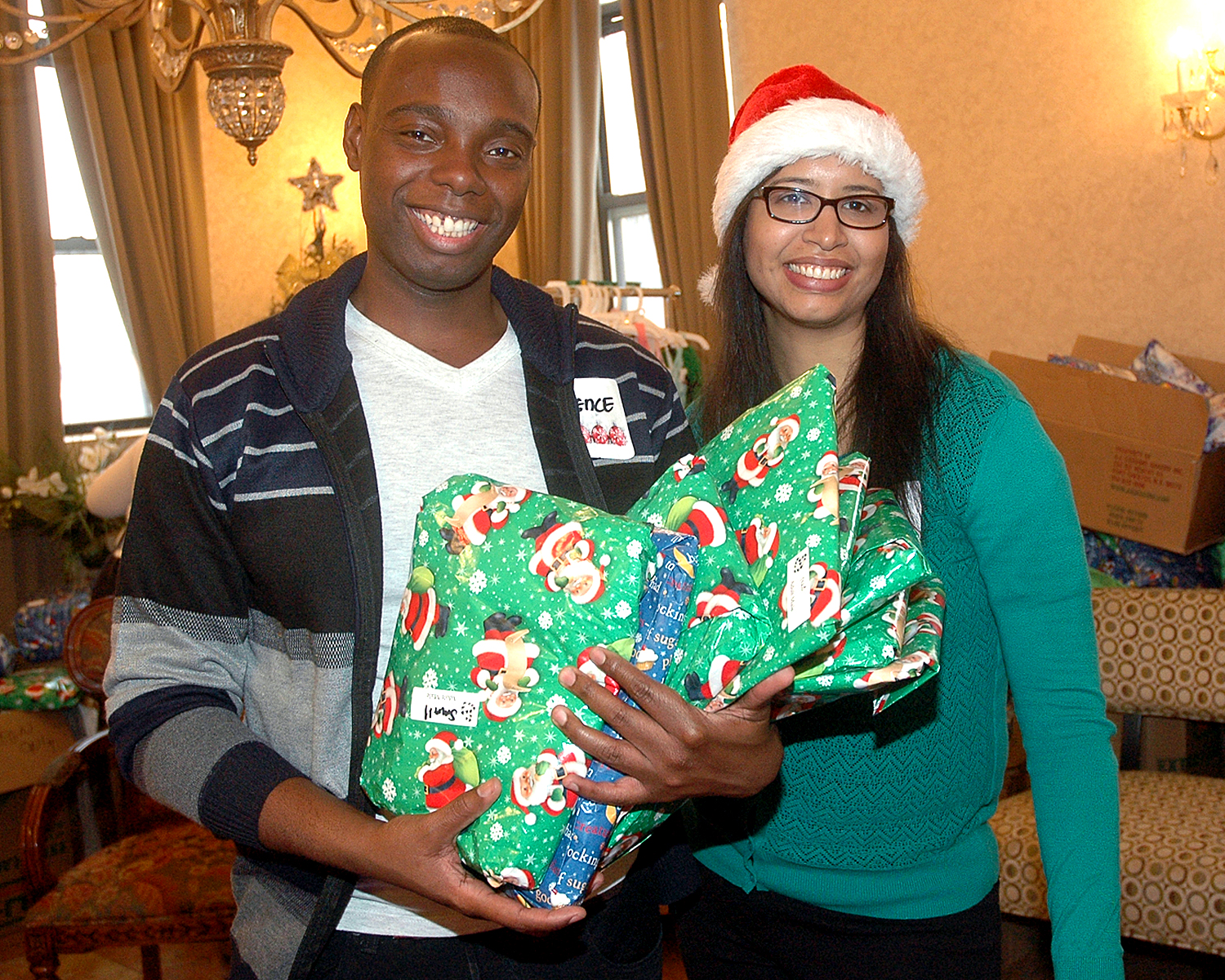 Staff members are ready to hand out holiday presents