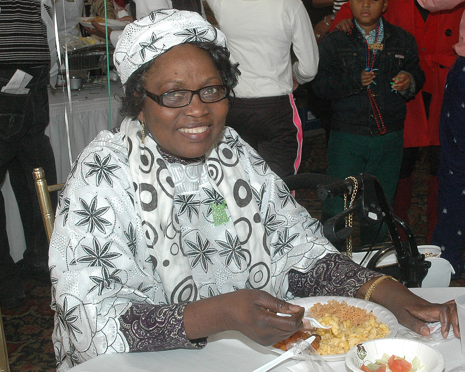 An attendee enjoying her meal