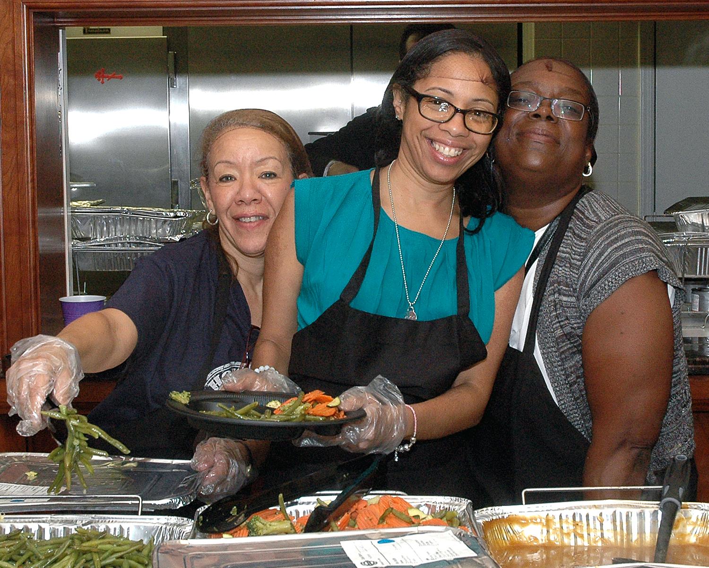 Maria Bautista, Ramona Cummings and Michelle Goree helping to serve food