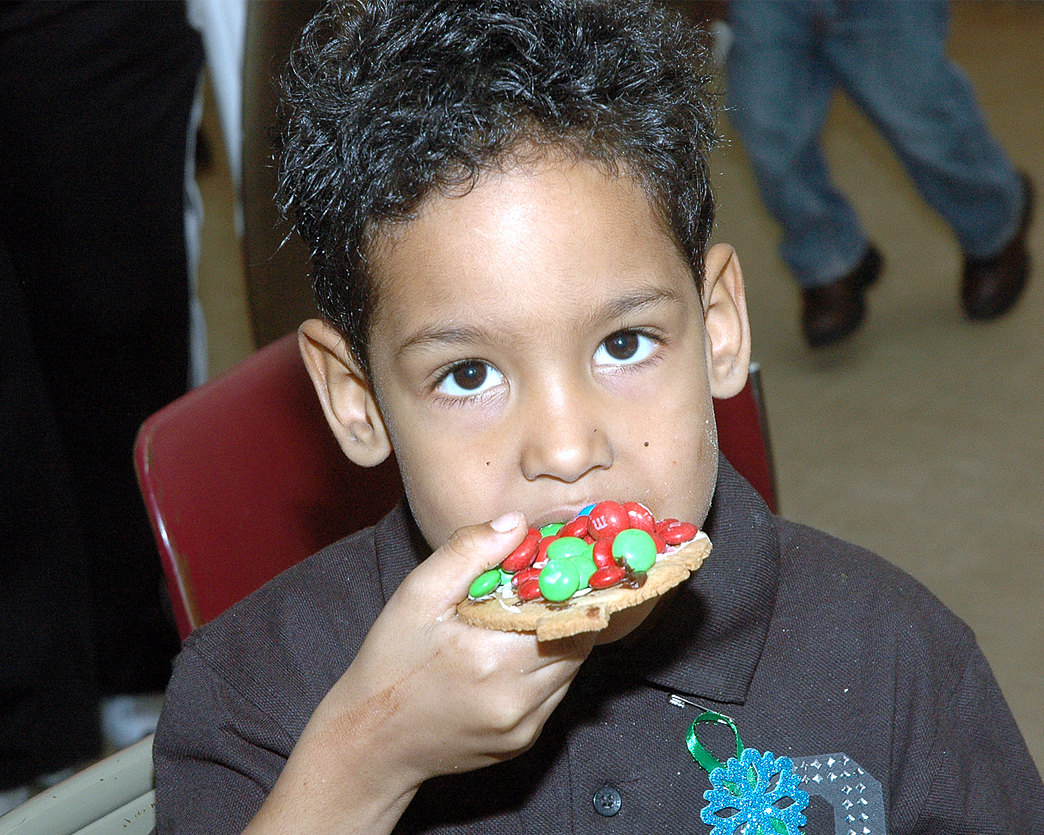 An attendee enjoying a cookie that he decorated