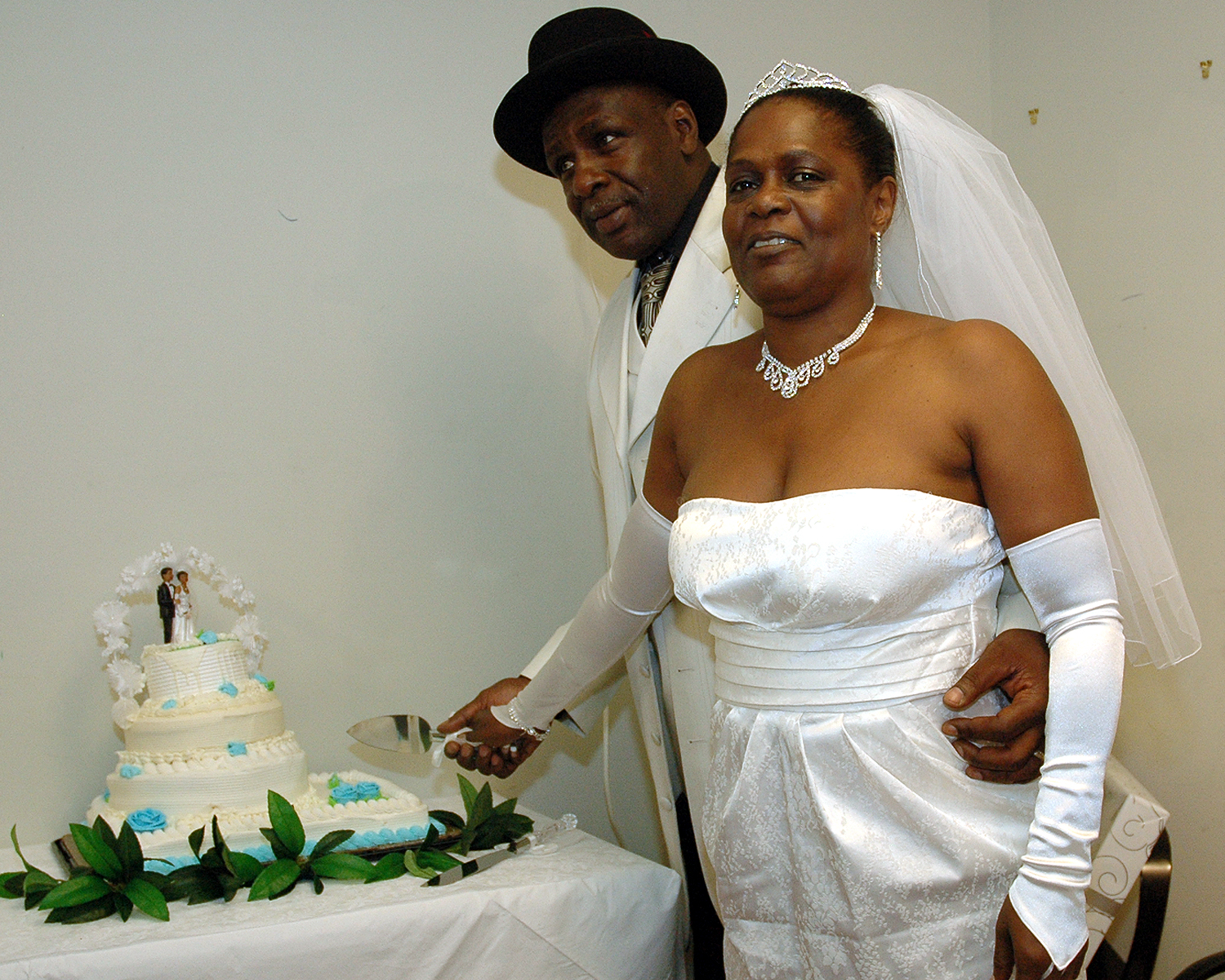 The Bride and Groom cutting their wedding cake
