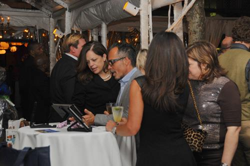 Guests Bid on Unmask AIDS Silent Auction
