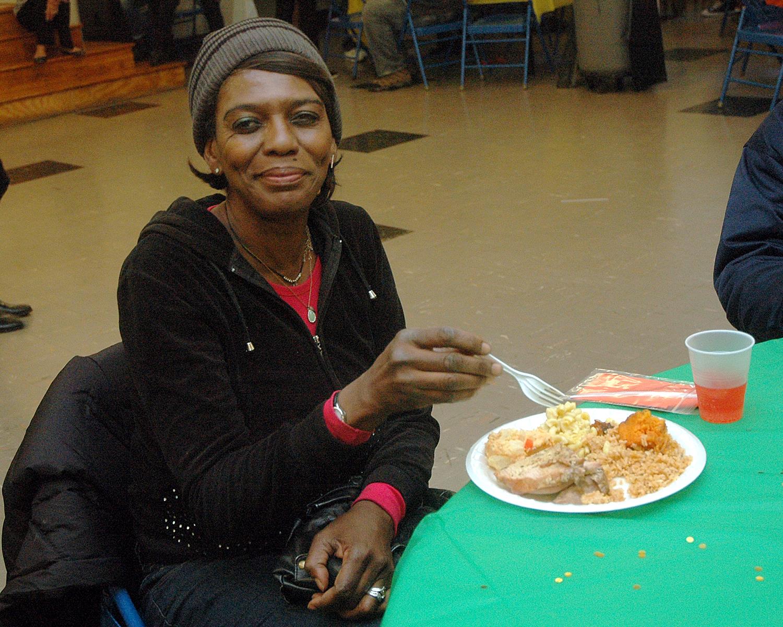An attendee enjoying their meal