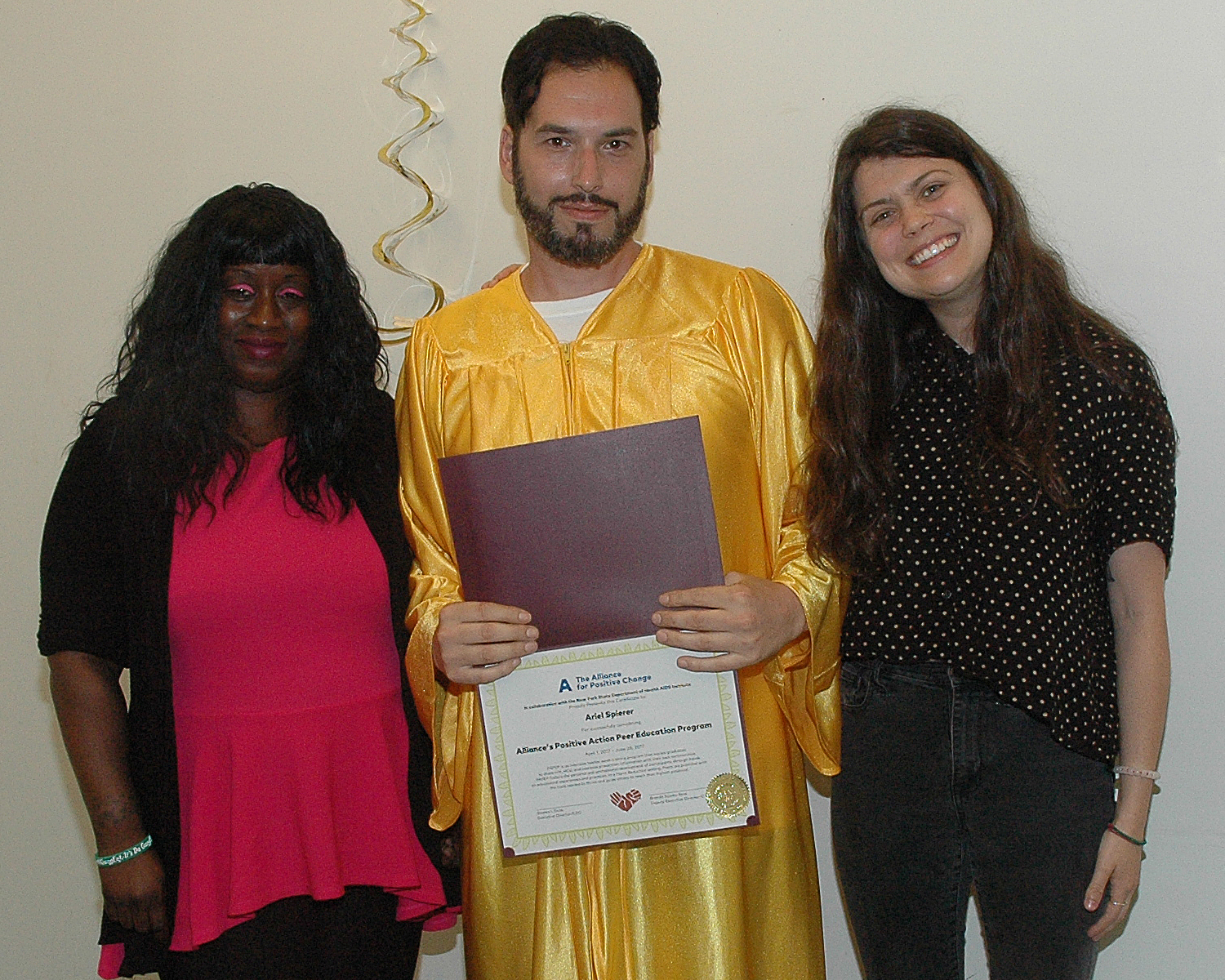 One of the graduates receiving his certificate
