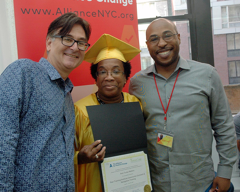 Avis M. with her certificate