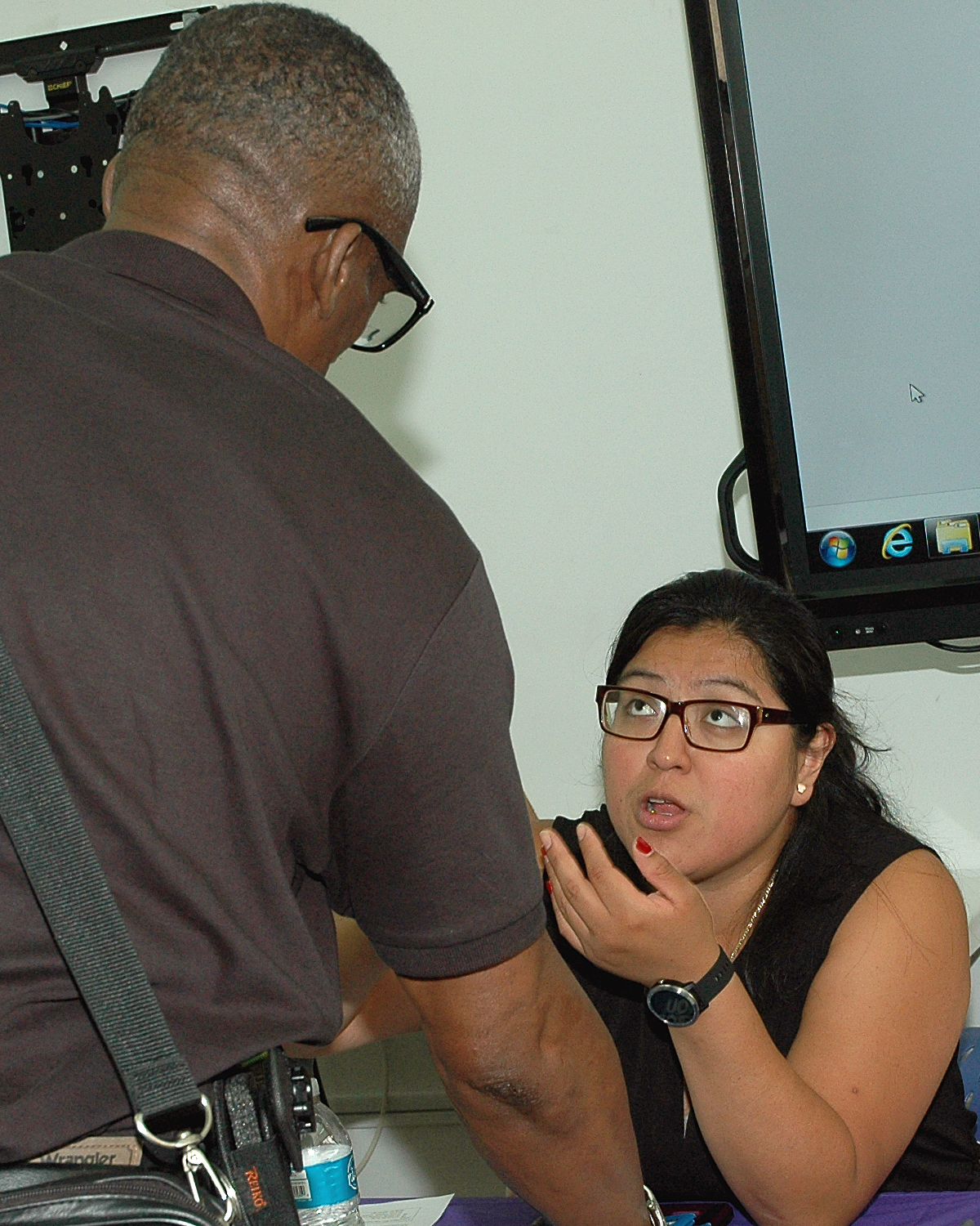 One of the job fair interviewers with an attendee