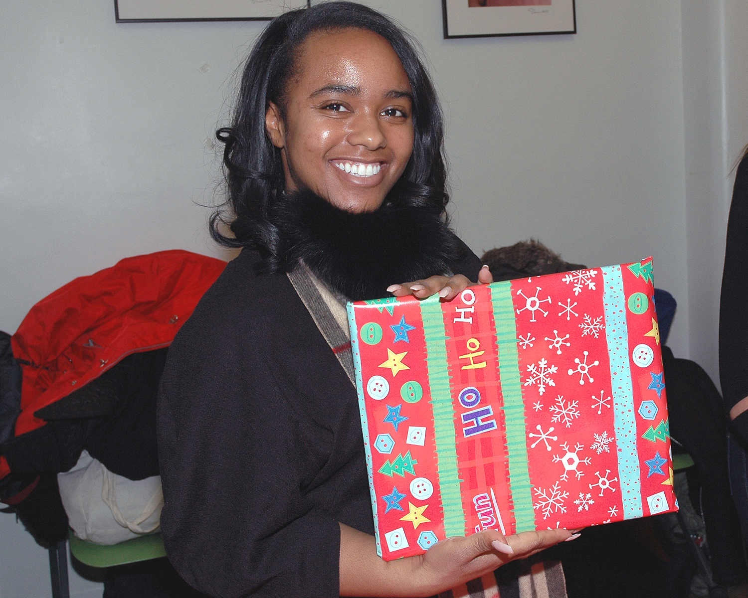 A volunteer showing the results of her gift wrapping